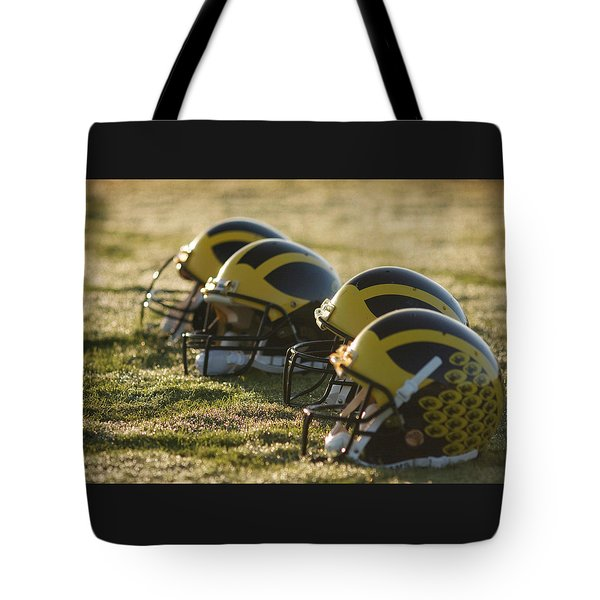 Helmets On The Field At Dawn Tote Bag