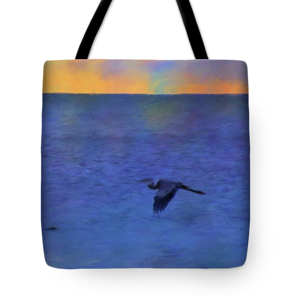 Tote Bag featuring the photograph Heron Across The Sea by Jan Amiss Photography