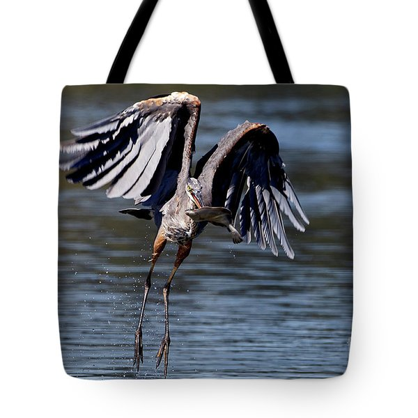 Great Blue Heron In Flight With Fish Tote Bag