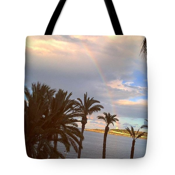 On A Sunny Island At The End Of A Rainbow Tote Bag by Sacha Kinser
