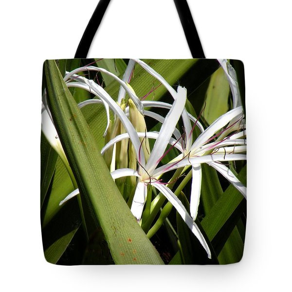 Tote Bag featuring the photograph Hidden Swamp Lily by Rosalie Scanlon