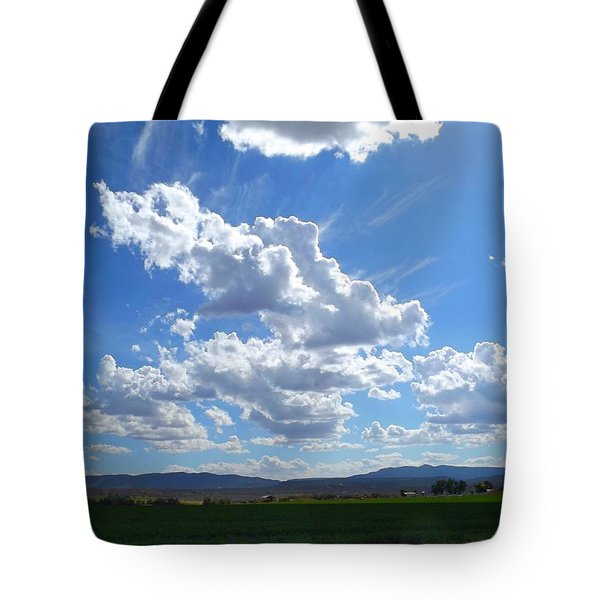 High Winds Chase The Rain Clouds Away Tote Bag by Annie Gibbons