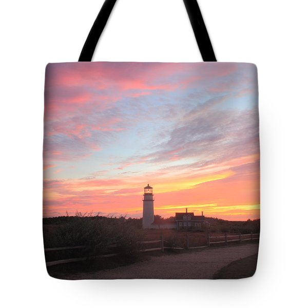 Highland Lighthouse Sunset Tote Bag by John Burk