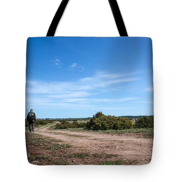 Tote Bag featuring the photograph Hiker At A Winding Trail by Kennerth and Birgitta Kullman
