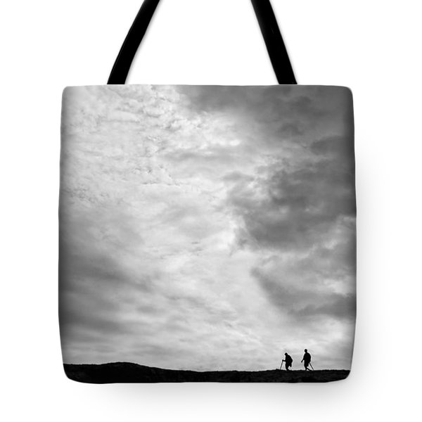 Tote Bag featuring the photograph Hikers Under The Clouds by Joe Bonita