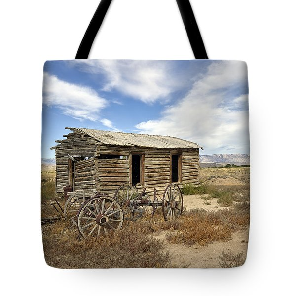 Historic Cabin And Buckboard Wheels In Big Horn County In Wyoming Tote Bag
