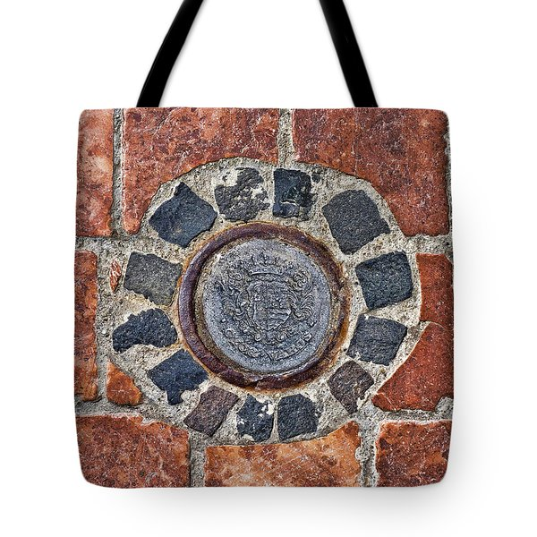 Tote Bag featuring the photograph Historic Pavement Detail With Hungarian Town Seal by Menega Sabidussi