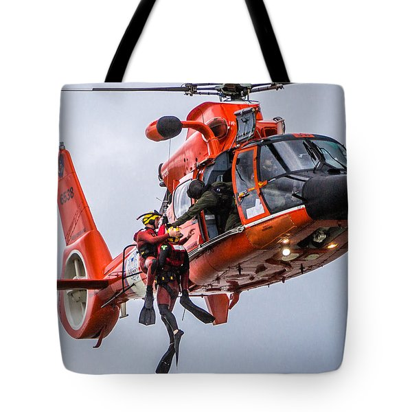 Tote Bag featuring the photograph Hoisting Into Helicopter by Gregory Daley  PPSA