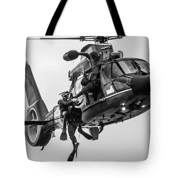 Hoisting Victim Into Helicopter Tote Bag