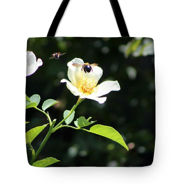 Honey Bees In Flight Over White Rose Tote Bag