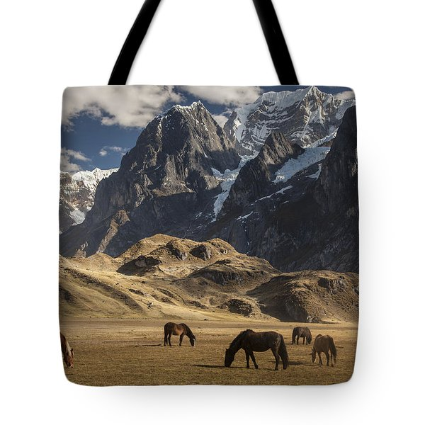 Tote Bag featuring the photograph Horses Grazing Under Siula Grande by Colin Monteath