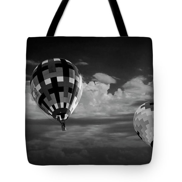 Hot Air Balloons Against A Cloudy Sky In Black And White Tote Bag