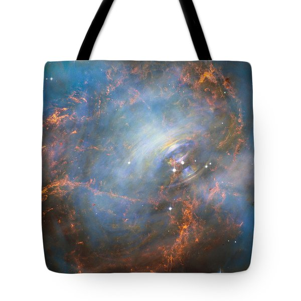 Tote Bag featuring the photograph Hubble Captures The Beating Heart Of The Crab Nebula by Nasa