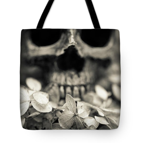 Tote Bag featuring the photograph Human Skull Among Flowers by Edward Fielding