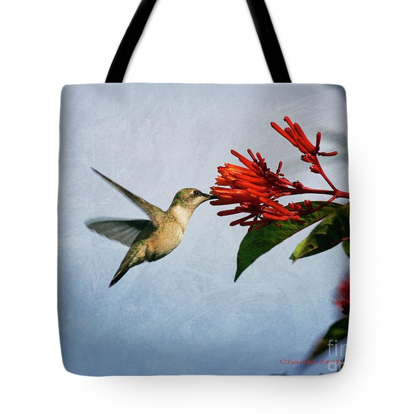 Tote Bag featuring the photograph Hummingbird Red Flowers by Charles McKelroy