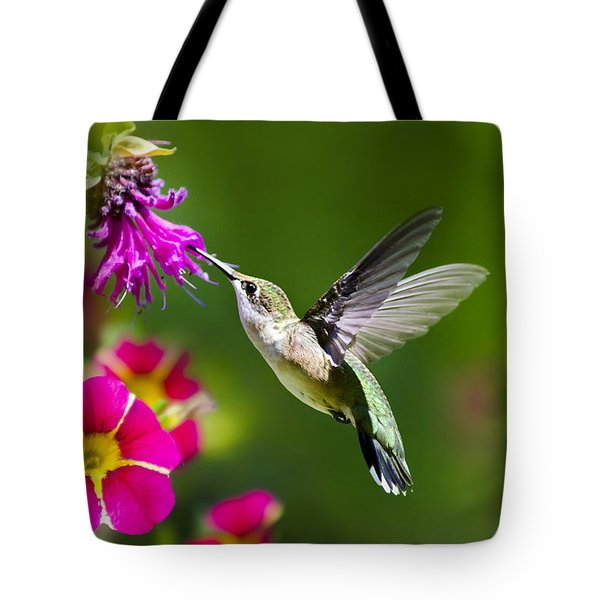 Tote Bag featuring the photograph Hummingbird With Flower by Christina Rollo