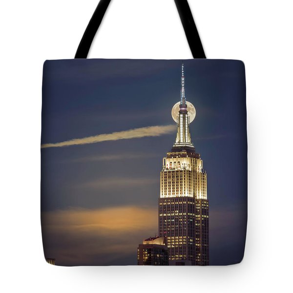 Tote Bag featuring the photograph Hunter's Moon by Eduard Moldoveanu