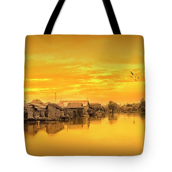 Tote Bag featuring the photograph Huts Yellow by Charuhas Images