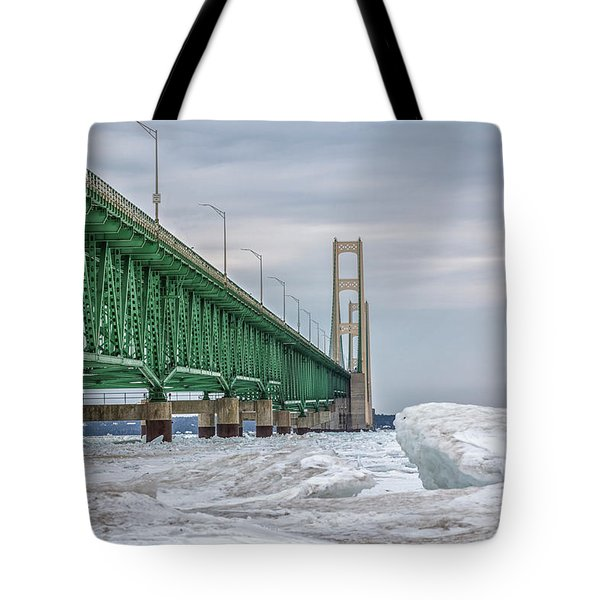 Tote Bag featuring the photograph Ice And Mackinac Bridge  by John McGraw