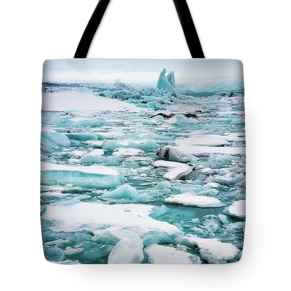 Tote Bag featuring the photograph Ice Galore In The Jokulsarlon Glacier Lagoon Iceland by Matthias Hauser