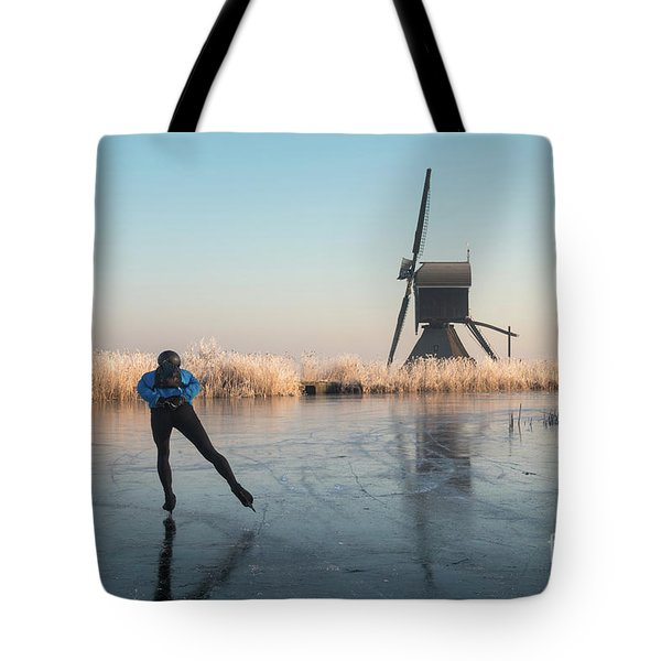 Ice Skating Past Frosted Reeds And A Windmill Tote Bag
