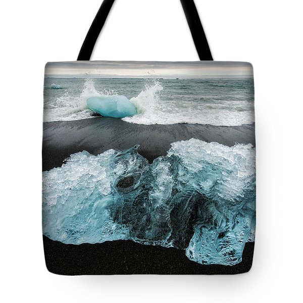 Tote Bag featuring the photograph Iceberg And Black Beach In Iceland by Matthias Hauser