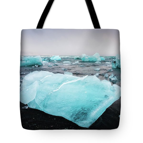 Tote Bag featuring the photograph Iceberg Pieces In Iceland Jokulsarlon by Matthias Hauser