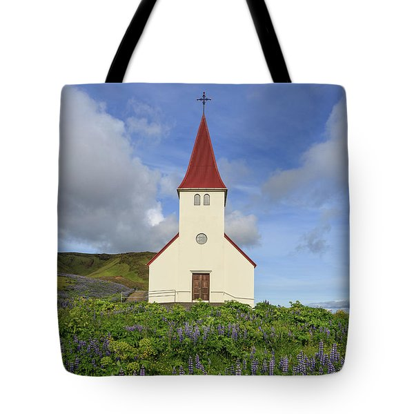 Tote Bag featuring the photograph Icelandic Church Among The Fields Of Lupine by Edward Fielding