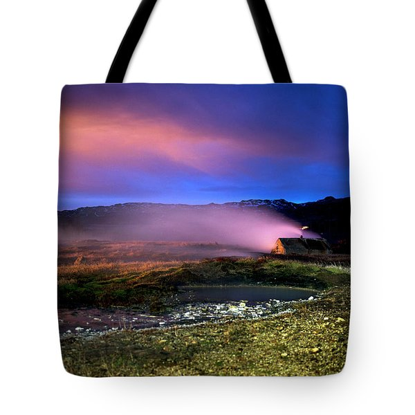 Tote Bag featuring the photograph Icelandic Geyser At Night by Dubi Roman