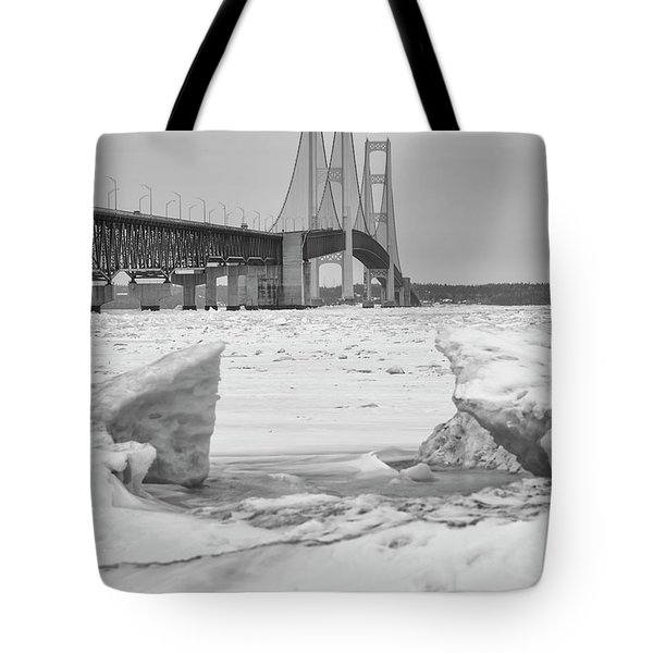 Tote Bag featuring the photograph Icy Black And White Mackinac Bridge  by John McGraw