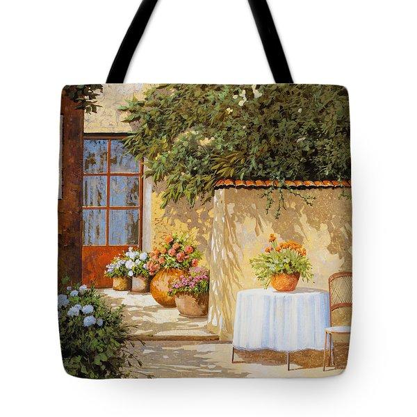 il muretto e il tavolo Tote Bag by Guido Borelli