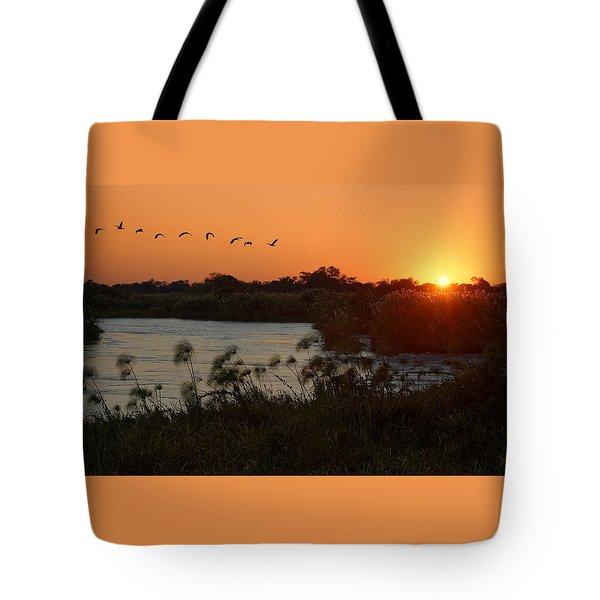 Impalila Island Sunrise Tote Bag by Joe Bonita