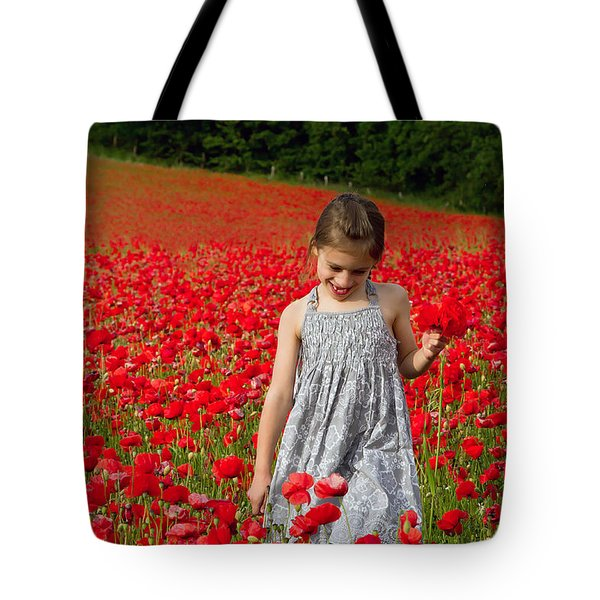 In A Sea Of Poppies Tote Bag by Keith Armstrong