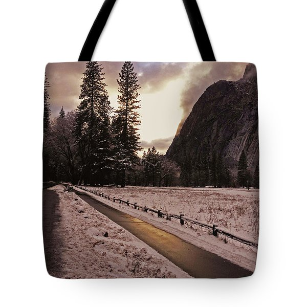 In Between Snow Falls Tote Bag by Walter Fahmy
