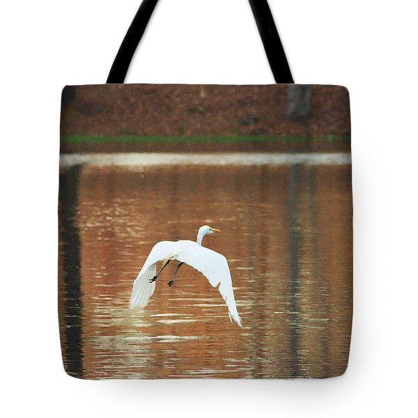 Tote Bag featuring the photograph In Flight by Kim Henderson