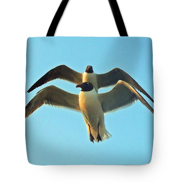 Tote Bag featuring the photograph In Tandem At Sunset by Sandi OReilly