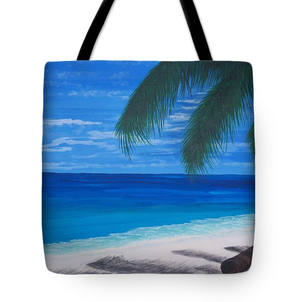 In The Shade Of A Palm Tote Bag by Nancy Nuce