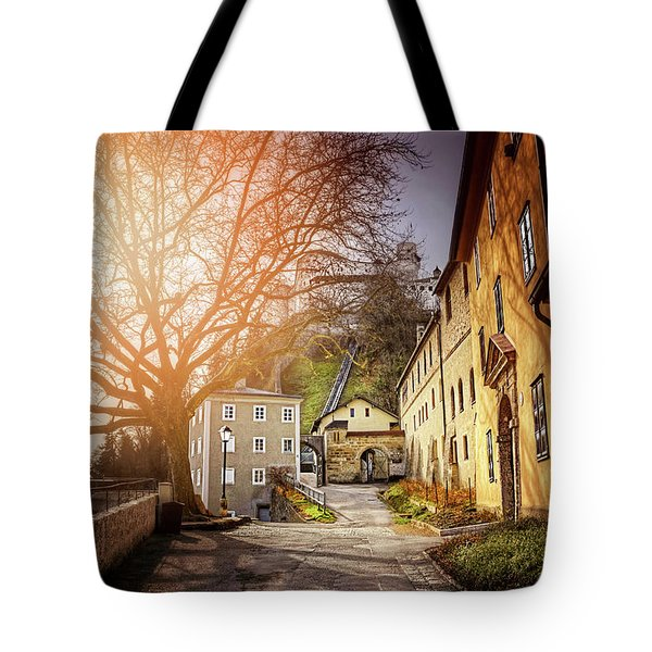Tote Bag featuring the photograph In The Shadow Of Salzburg Castle  by Carol Japp