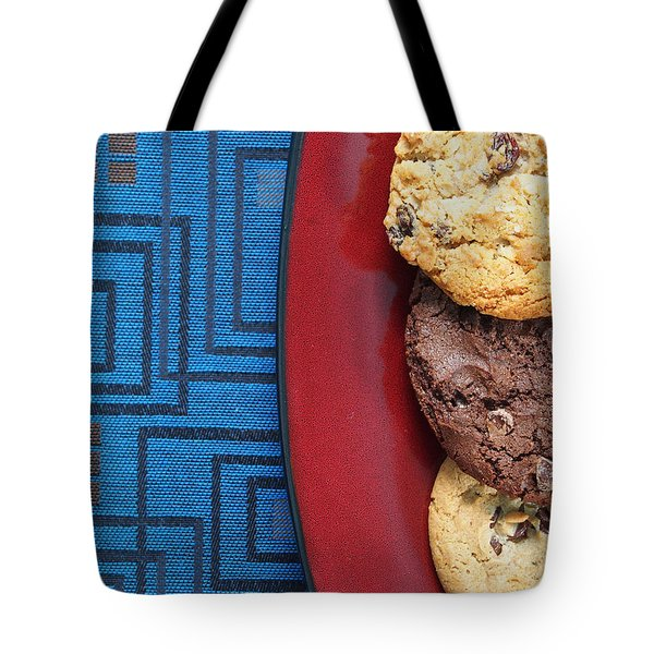 Tote Bag featuring the photograph Indulgent by Tom Druin