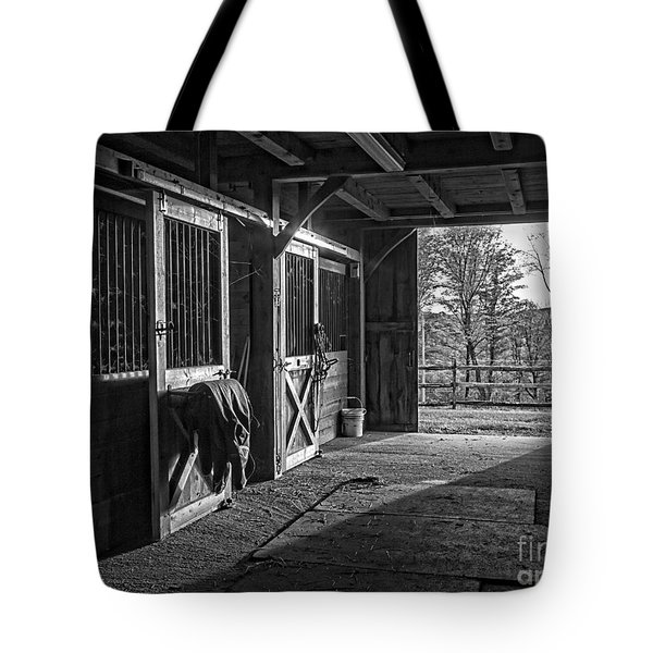 Tote Bag featuring the photograph Inside The Horse Barn Black And White by Edward Fielding
