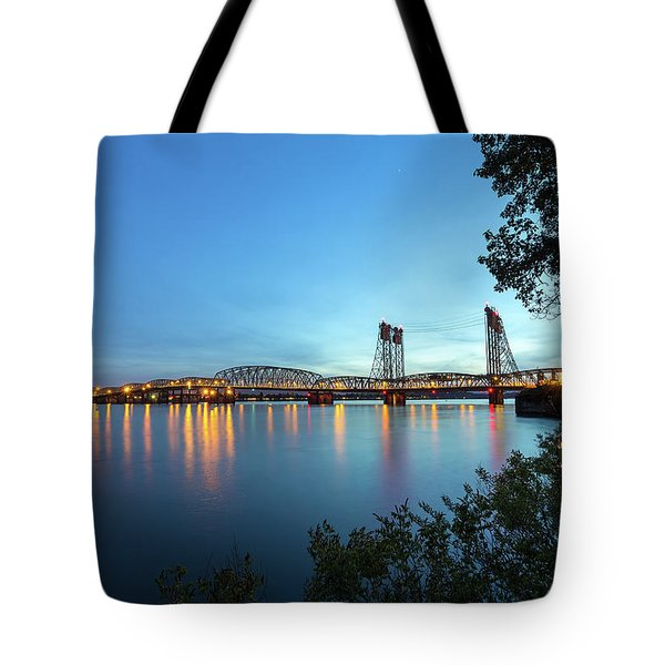 Interstate Bridge Over Columbia River At Dusk Tote Bag by David Gn