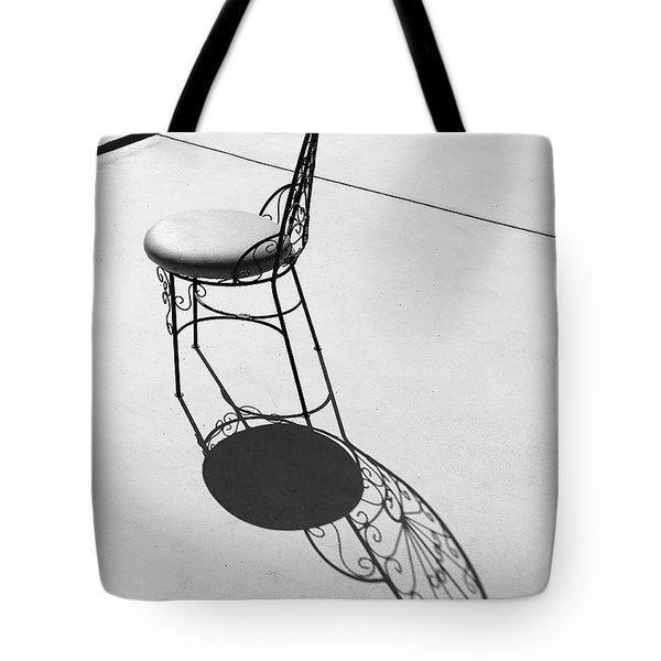 Tote Bag featuring the photograph Iron Chair And Its Butterfly Shadow by Viktor Savchenko
