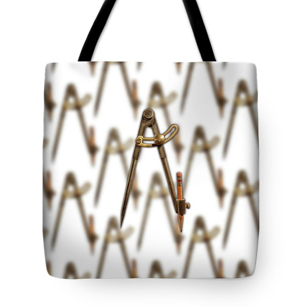 Tote Bag featuring the photograph Iron Compass Pattern by YoPedro