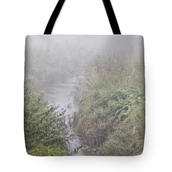 Tote Bag featuring the photograph It Flows From The Mist by Odd Jeppesen