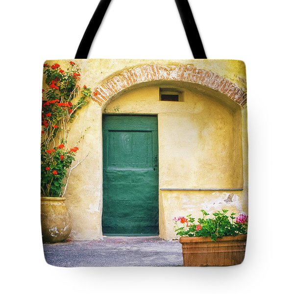 Tote Bag featuring the photograph Italian Facade With Geraniums by Silvia Ganora