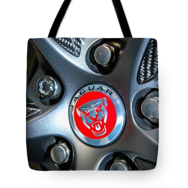 Tote Bag featuring the photograph Jaguar Hubcap by Robert Hebert