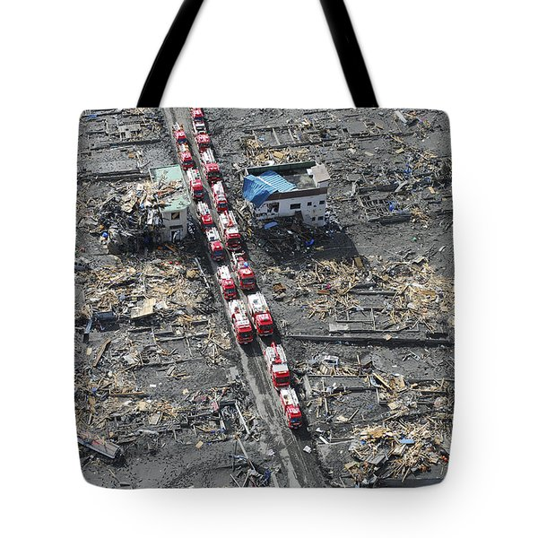 Japanese Fire Trucks Line A Road Tote Bag by Stocktrek Images