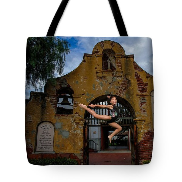 Joyful Jump Tote Bag by Robert Hebert