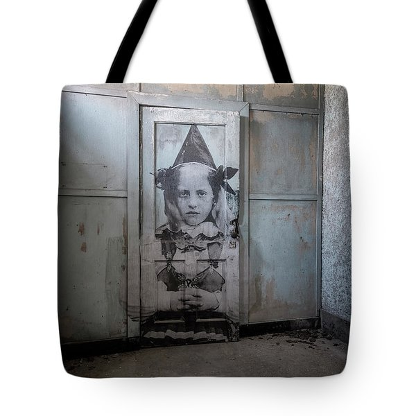 Tote Bag featuring the photograph Jr On The Door by Tom Singleton