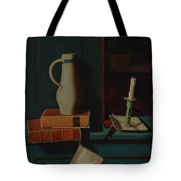 Jug, Books, And Candle On A Cupboard Shelf Tote Bag